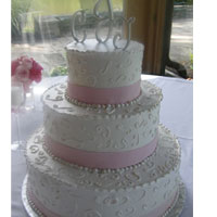 buttercream cake with scrolls and fondant pearls